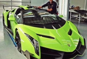 Valentino Balboni poses beside a Lamborghini Veneno Roadster painted in Verde Singh