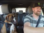 Vaughn Gittin Jr. and his dog go for a drive