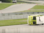 Volkswagen bus on its side is actually a race car