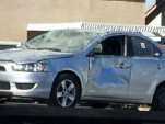 wrecked mitsubishi lancer