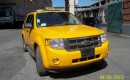 2009 Ford Escape Hybrid New York taxi (Image: eBay Motors)