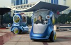 GM's Future City-Car Vision: Autonomous, Electric, Two-Wheeler