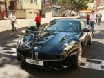 Prince Albert of Monaco and Henrik Fisker drive Fisker Karma on Monaco Grand Prix circuit, May 2011