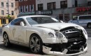 Wrecked 2013 Bentley Continental GT at the curb on a street in Manhattan