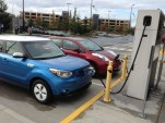 2015 Kia Soul EV and 2014 Nissan Leaf, at Blink DC fast charger  -  Fife, WA