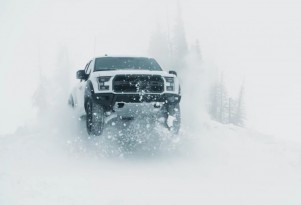 Ken Block drives the Ford F-150 Raptor in the snow