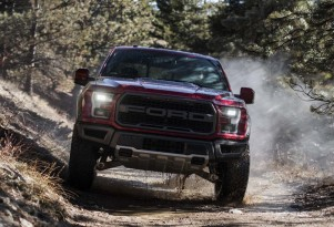 Dodge Challenger Hellcat and Ford F-150 Raptor race around, over a mountain
