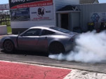 818 kit car with Tesla motors and a Volt battery rips down the quarter mile