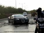 A Bugatti Veyron tackles a speed bump.