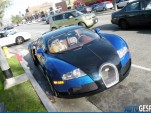 A golden retriever sits in the passenger seat of a Bugatti Veyron in L.A.