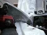 A hydraulic tool cuts apart the Tesla Model S