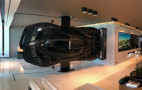 Race driver hangs Pagani Zonda Revolucion as wall art