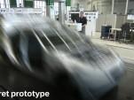 A secret prototype disguised on film at BMW's Plant Zero