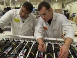 A123 Systems Employees Perform Quality Check on a Lithium-Ion Battery Pack  [source: A123 Systems]
