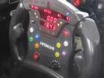 An IndyCar steering wheel, showing the green push-to-pass button - image: IndyCar