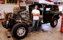 "Artist Jeremy Dean with half a Hummer H2 for his work, ""Back to the Futurama,"" January 2010"