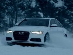 Audi's A6 quattro plays in the snow.