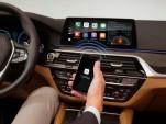 Electric cars: lease or buy? LAPD's BMWs, Tesla Autopilot crash, Exxon climate suits: Today's Car News