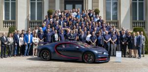 Bugatti staff and the 100th Chiron at Bugatti's headquarters in Molsheim, France