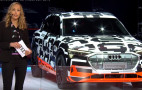 Audi e-tron electric SUV appears in camouflage at Geneva show, on city roads