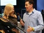 Carolla interviews manufacturer rep at NY Auto Show. Photo via SpeedTV.