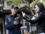 Celina Jade shows Sebastian Vettel some martial arts techniques