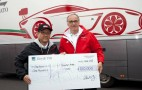 Aston Martin Presents Proceeds From Rapide Auction To Toyota