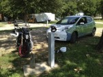 Zero S electric motorcycle charging next to Nissan Leaf during Ride the Future Tour  [Ben Rich]