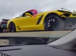 Crashed 2015 Chevrolet Corvette Z06 on a flatbed in Chicago