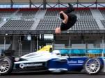 Damien Walters backflip over a moving Formula E race car