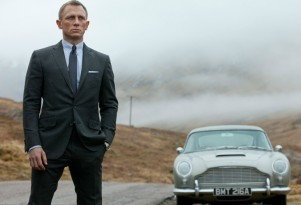 Daniel Craig as James Bond, Agent 007, in Skyfall, with Aston Martin DB5