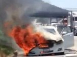 Dick Van Dyke's Jaguar XJ burning on a Los Angeles highway