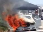 Dick Van Dyke's Jaguar XJ burning on a Los Angeles highway
