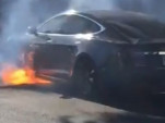 Director Michael Morris's Tesla Model S on fire [PHOTO CREDIT - MARY MCCORMICK]