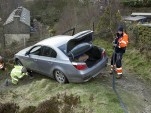 Emergency workers in Tormoden, West Yorkshire, rescue a BMW 5-Series. Photo: Ross Parry / Daily Mail