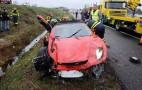 Father and son survive Ferrari F430 crash