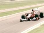 Fernando Alonso in a Ferrari F1 car at Fiorano