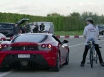 Ferrari F430 Scuderia drag races a rocket-powered bicycle