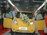 First Tata Nano rolls out of new Sanand factory on June 2, 2010, with founder Ratan Tata at left