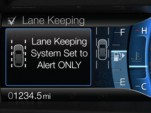 Ford's Lane Keeping System, available on the 2013 Fusion sedan.