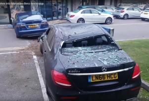 Frame from video showing Tesla Model S after it hit Mercedes dealership  [source: RatDog on YouTube]