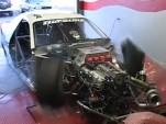 Front-drive drag car blows a tire on the dyno
