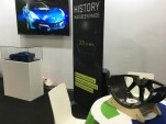 Genovation displays Carbon Revolution carbon fiber wheel at 2016 Big Boys Toys show