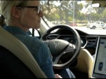 GigaOm's Katie Fehrenbacher behind the wheel of a 2012 Tesla Model S (video screen capture)