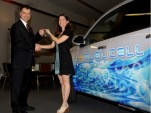 GM's Charlie Freese hands keys to a new fuel cell vehicle to Stephanie White