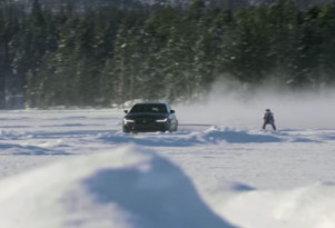 Graham Bell hit 117 mph on skis while being towed behind a Jaguar XF Sportbrake