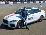 Haas Formula One driver Romain Grosjean and the 2016 Jaguar XF