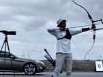 Hyundai Genesis Coupe races an arrow