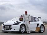 Jacques Villeneuve and his 2014 Peugeot 208 World Rallycross Championship race car