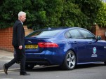 John McEnroe drives the new Jaguar XE at Wimbeldon